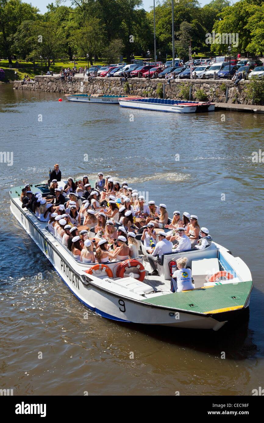 Happy students who celebrate the student with a canal trip in Gothenburg - Stock Image