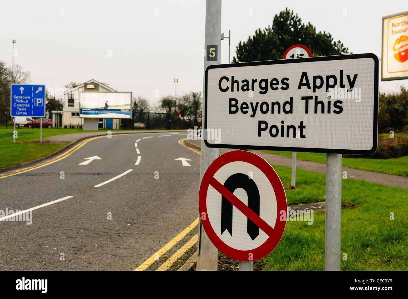 Sign at approach to airport terminal, warning that charges apply beyond this point - Stock Image