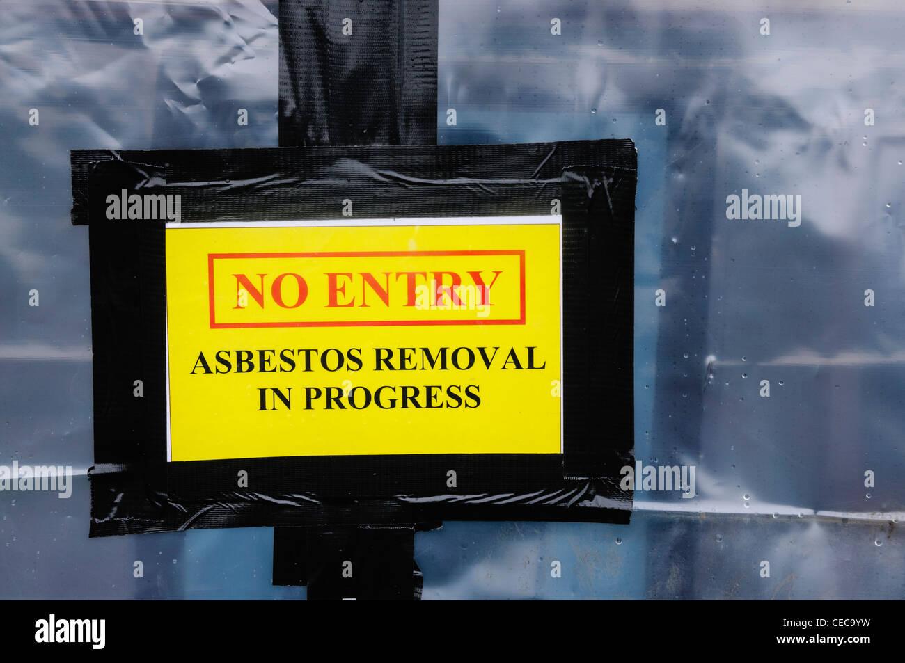 Warning sign at an Asbestos clean-up - Stock Image