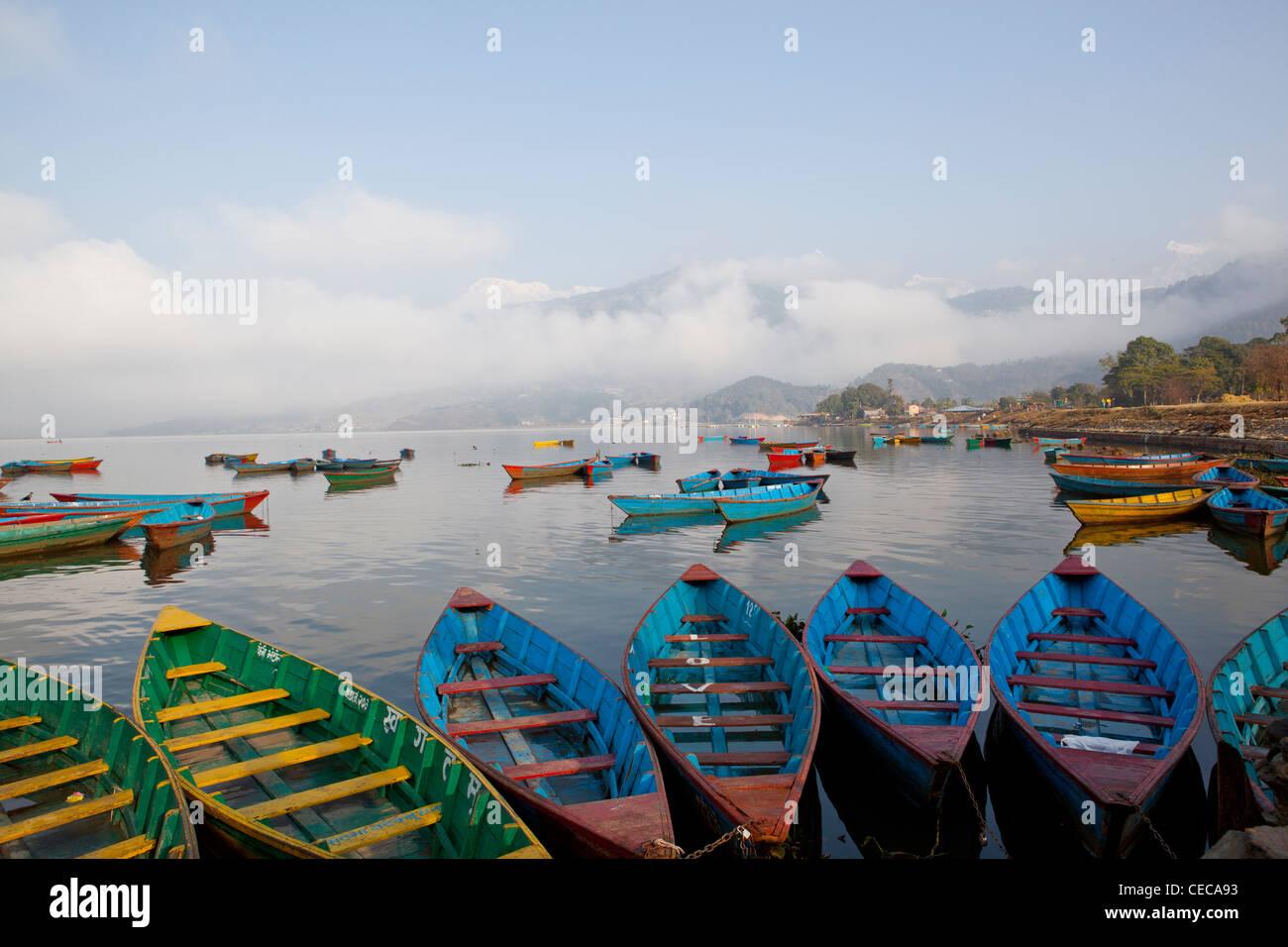 Colourful boats Phewa Lake Pokhara Himalaya overview Nepal Asia - Stock Image