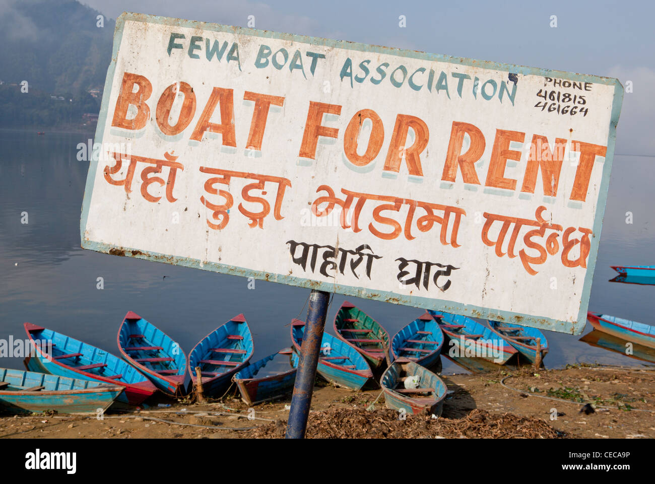 Boat for rent sign colourful boats Phewa Lake Pokhara Nepal Asia - Stock Image