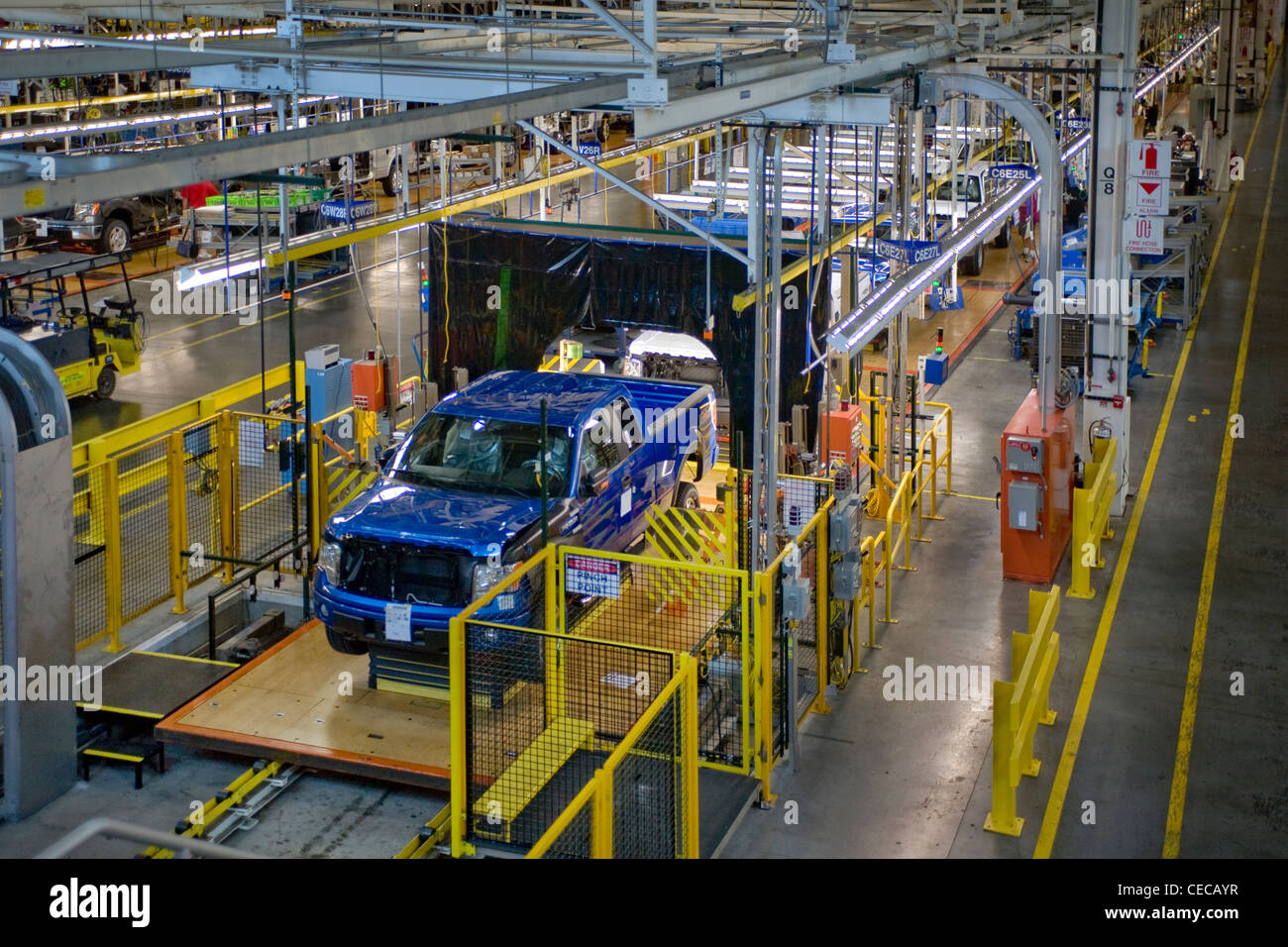 Partially completed F-150 pickup trucks move down the production line at the Ford River Rouge factory in Dearborn, - Stock Image
