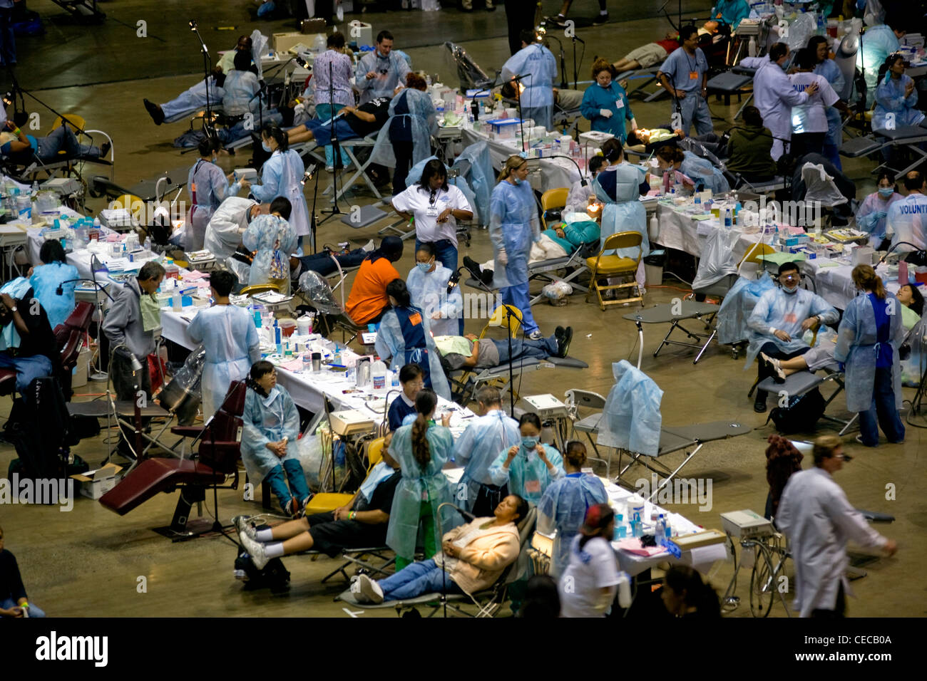 Hundreds of indigent people receive free dental care in Inglewood, CA. Organized by the Remote Area Medical organization - Stock Image