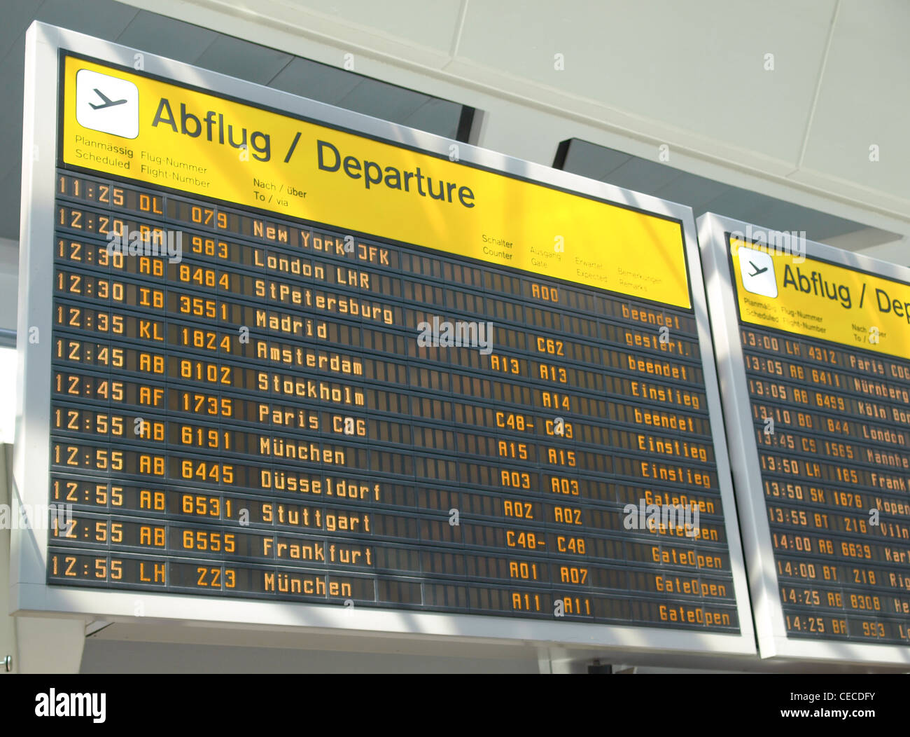 Timetable display screen of arrivals and departures at station or airport - Stock Image