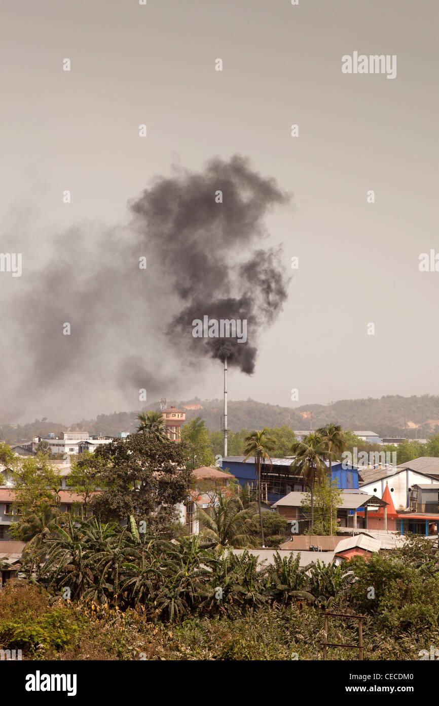 India, Assam, Guwahati, Amingaon, Assam Export Promotion Industrial Park (EPIP) chimney emitting black smoke Stock Photo