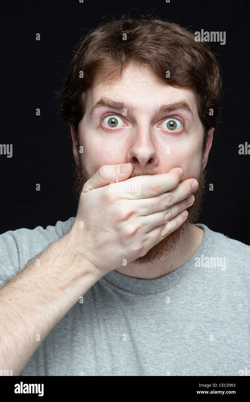 Secret concept - young man amazed by gossip news - Stock Image