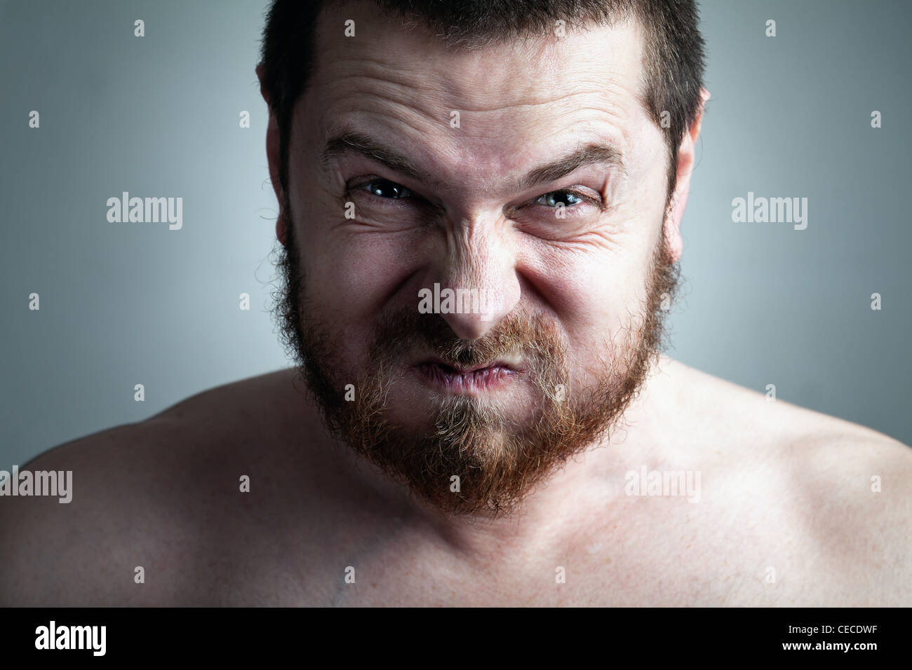 Stress or constipation concept - man with funny grimace - Stock Image