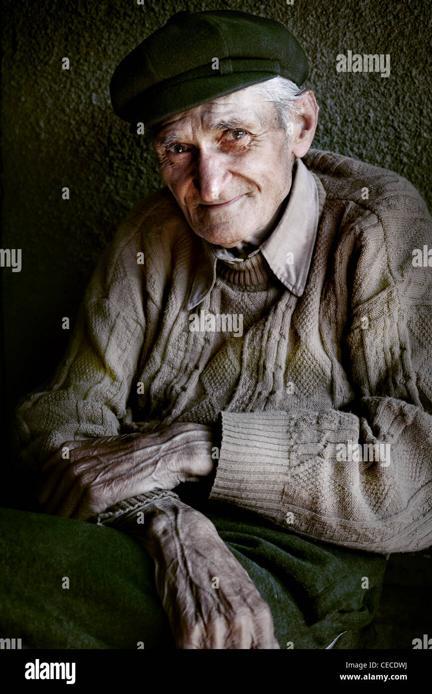 Content senior old man with expressive eyes - Stock Image