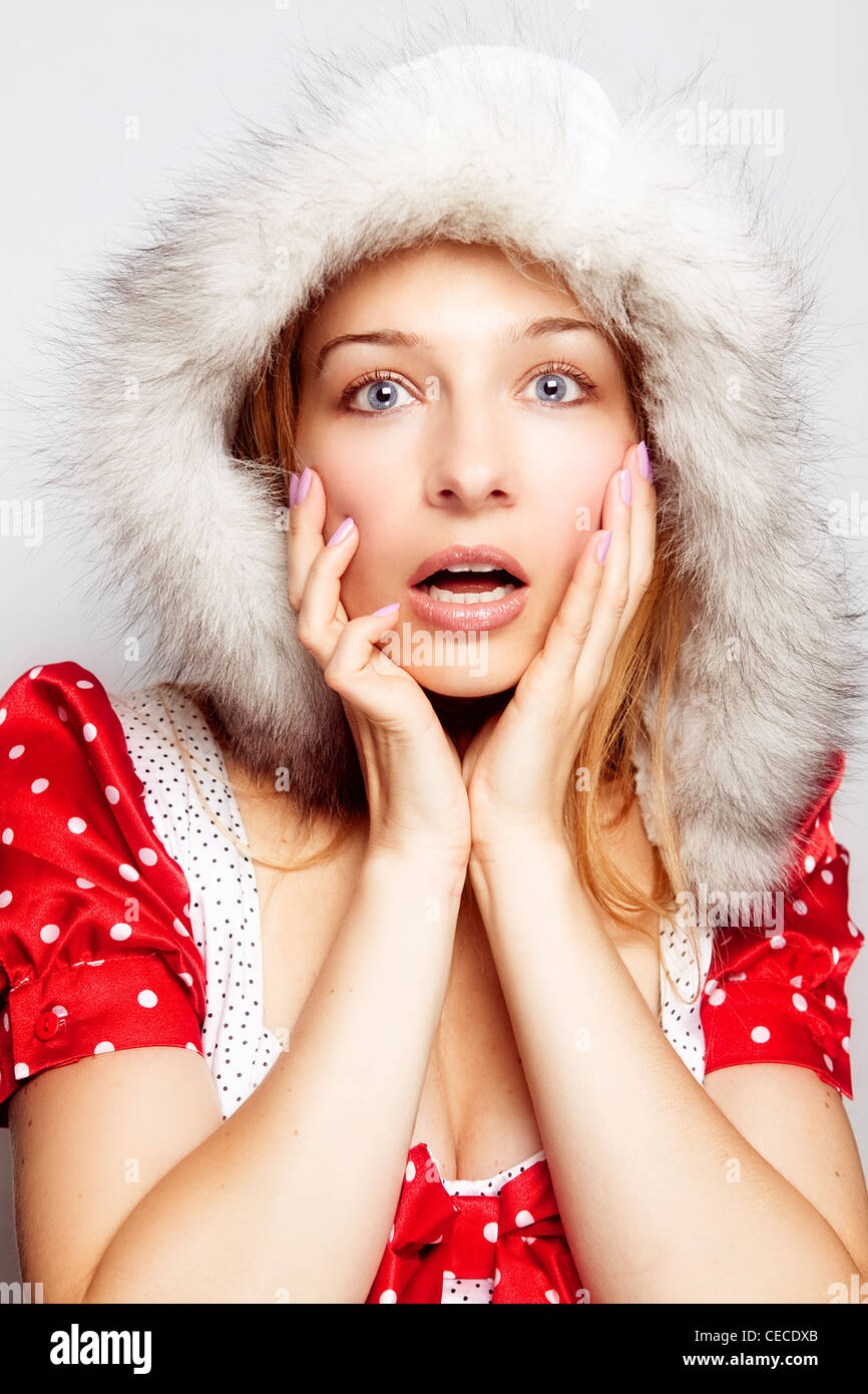 Winter surprise concept - cute amazed young woman - Stock Image