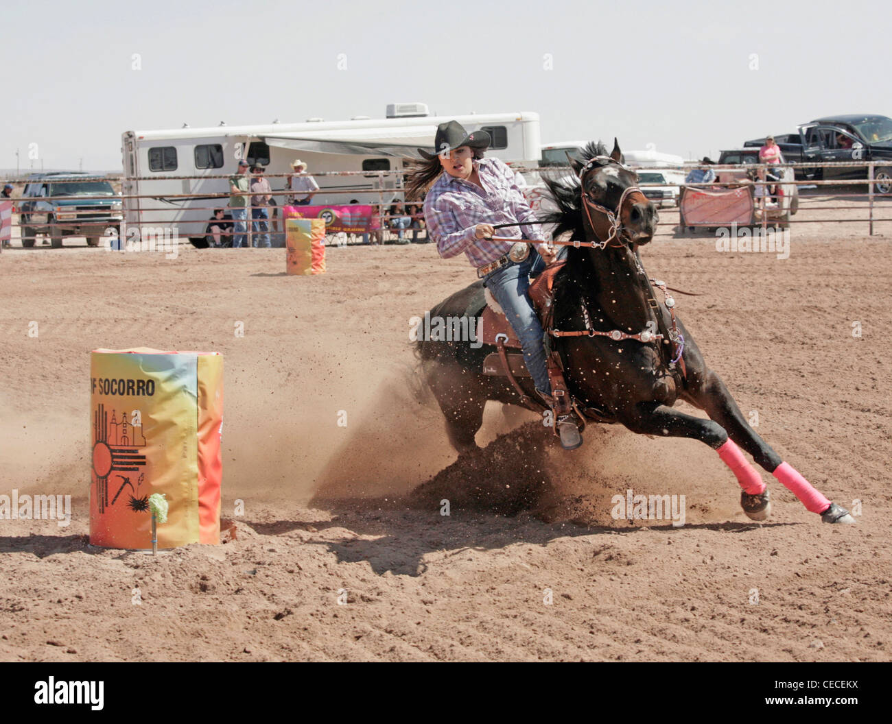 Socorro, New Mexico, USA. Woman taking part in the barrel racing event during the annual rodeo held in Socorro, - Stock Image