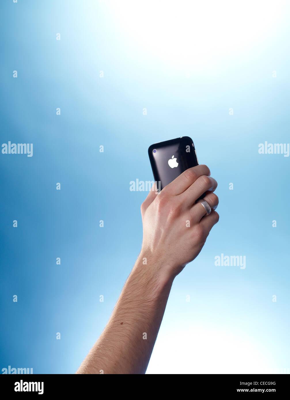 iPhone held aloft - Stock Image