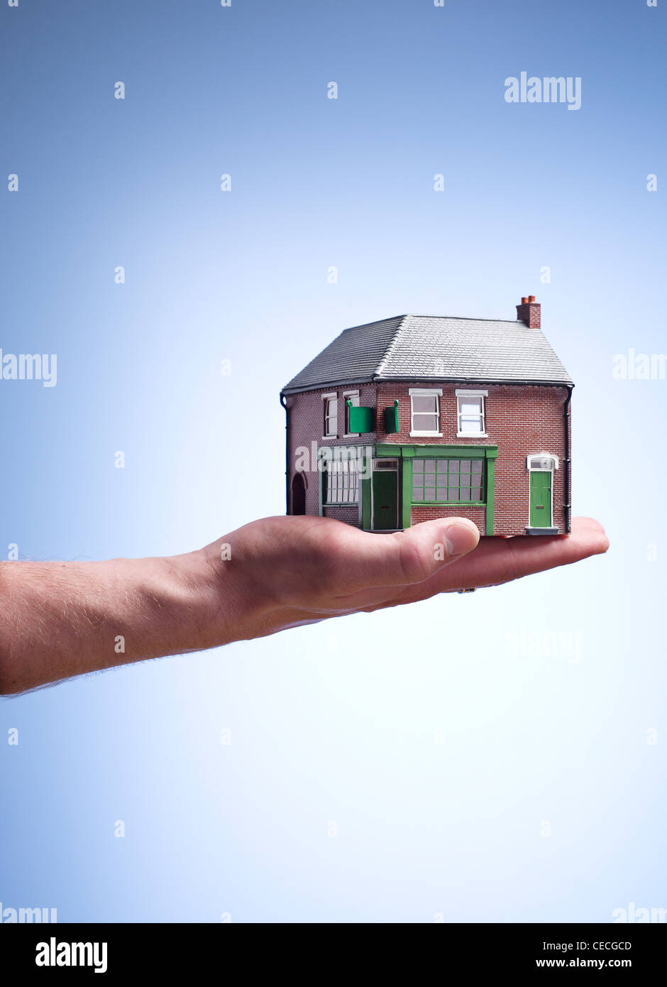 A house held in a hand - Stock Image