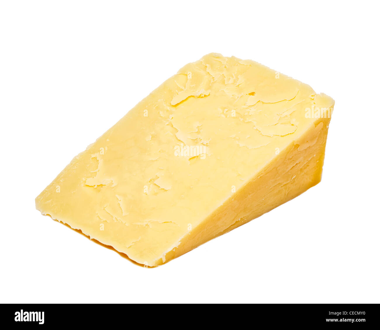 Cheddar cheese on white background - Stock Image