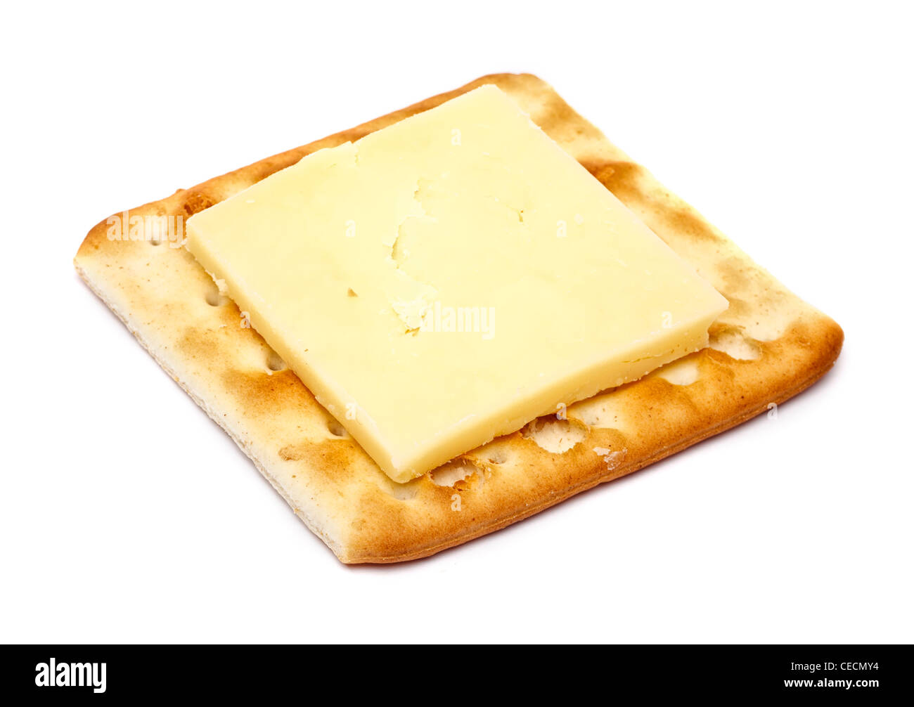 Cheddar cheese on a cracker - white background - Stock Image