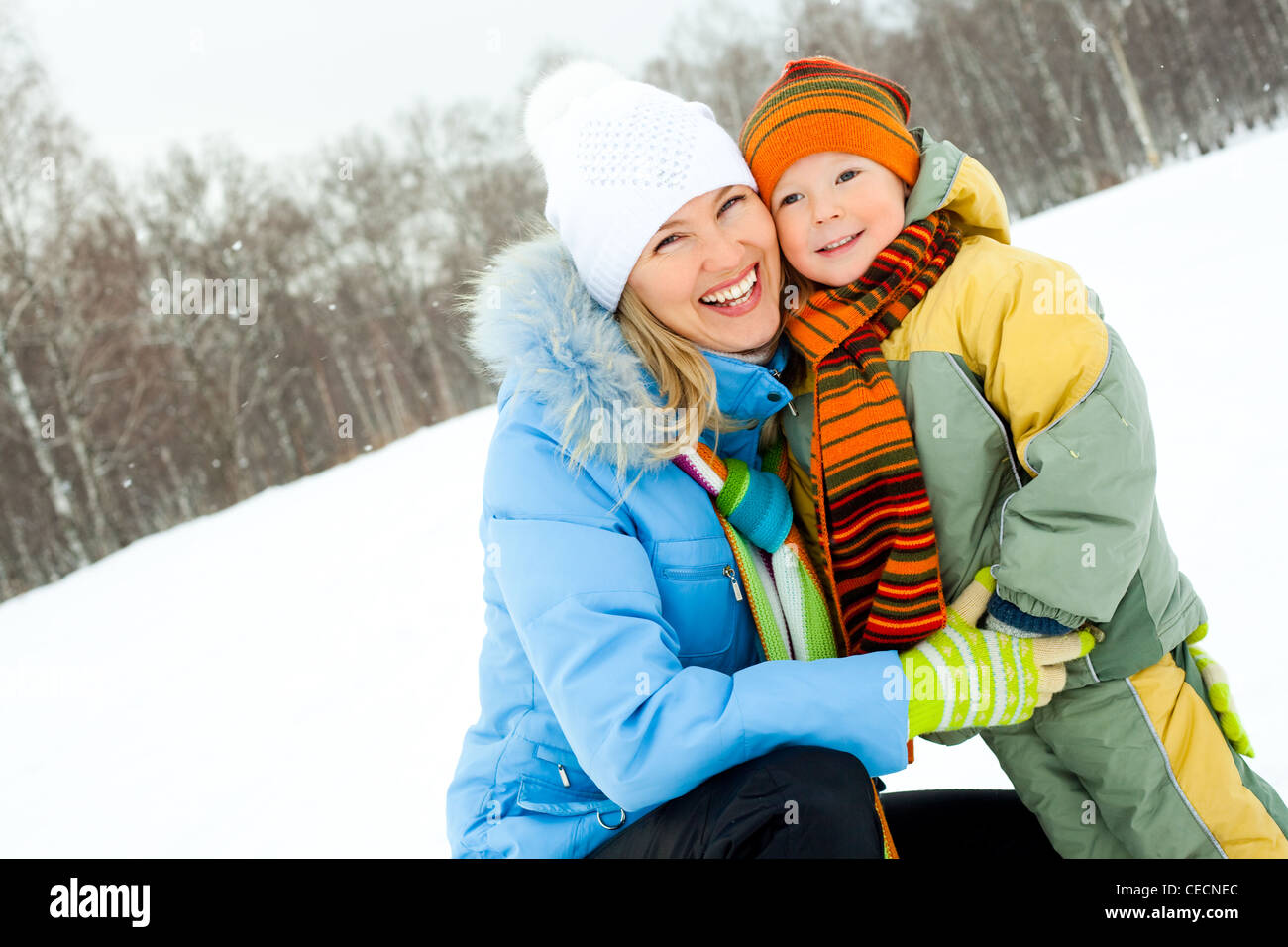 happy mother and son in the winter park Stock Photo