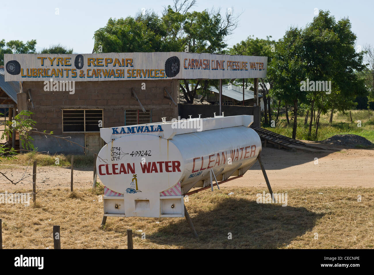 Old fuel tanker used to advertise the delivery of clean drinking water in Korogwe Tanzania Stock Photo