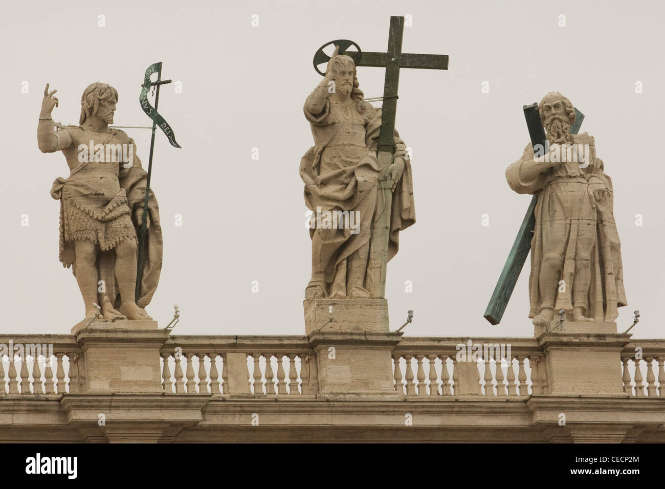 Statues of Jesus carrying the cross on the top of St. Peter's Basilica Basilica di San Pietro Vatican city Rome Stock Photo
