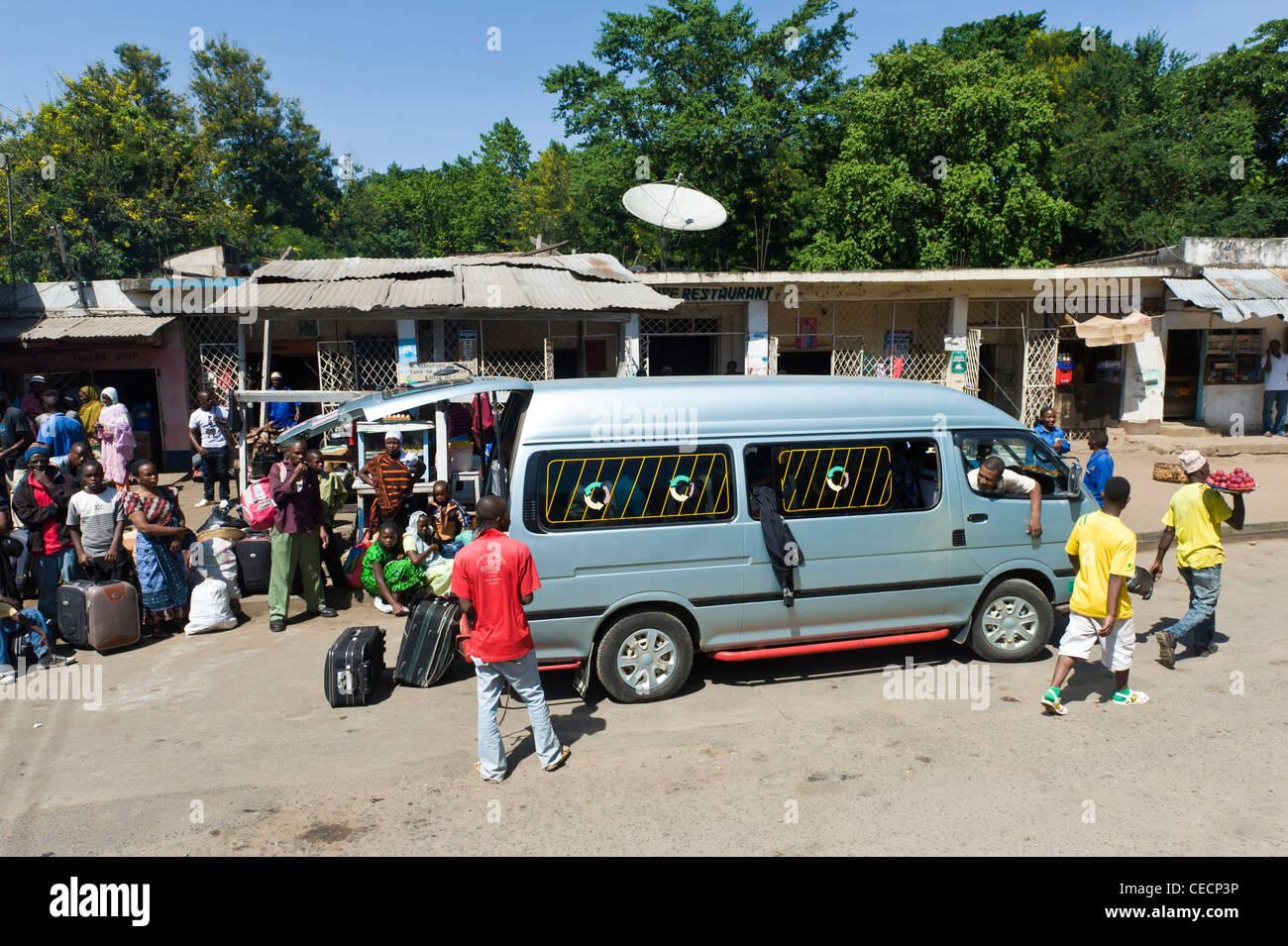 Passengers getting on a minibus in Mombo in Tanga Region Tanzania - Stock Image