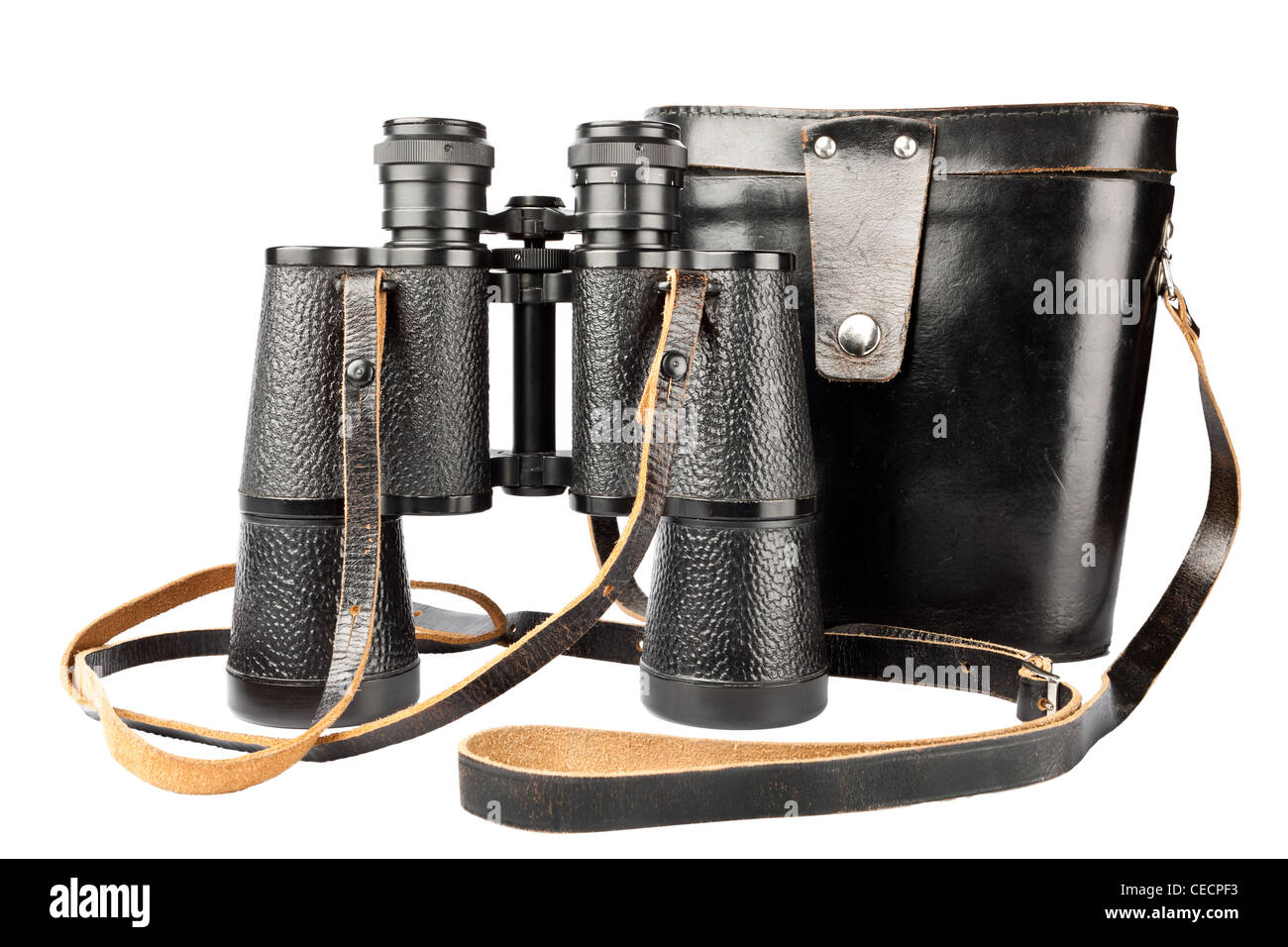 Old antic binocular coated with leather and it's black case with a long strap, isolated on white background - Stock Image