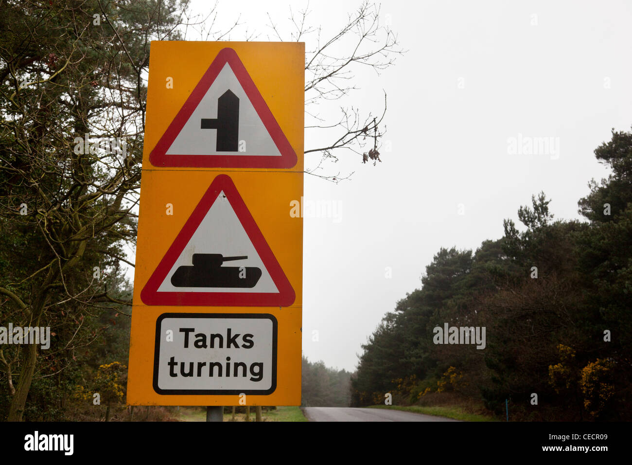 Road sign warning of tanks turning, Bovington Camp, Dorset, England. - Stock Image