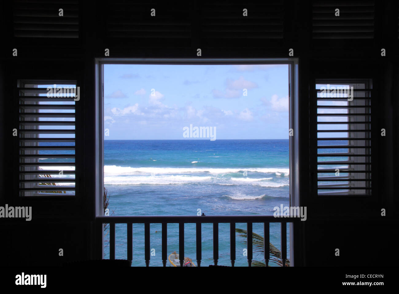 A window looking out onto the Atlantic Ocean on the east side of Barbados, West Indies - Stock Image