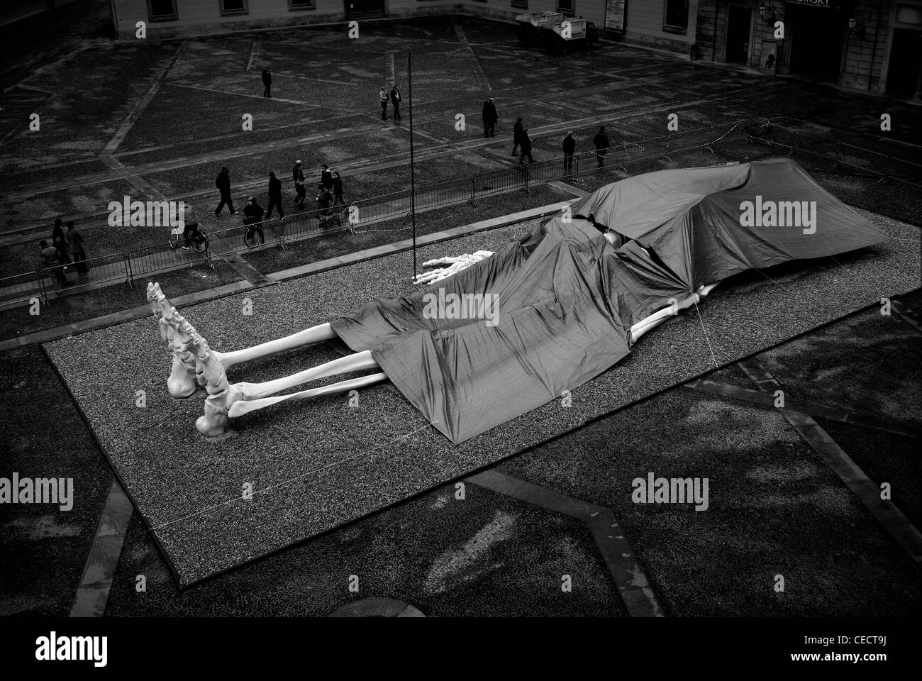 Milan, Italy. Big skeleton in public square - Stock Image