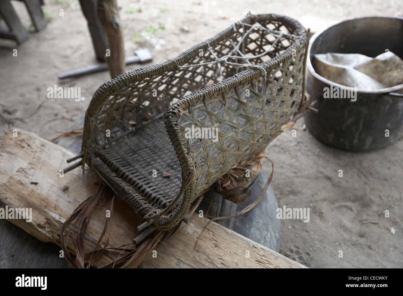 A traditional Amerindian woven carrying basket, Rewa, Rupununi, Guyana, South America - Stock Image