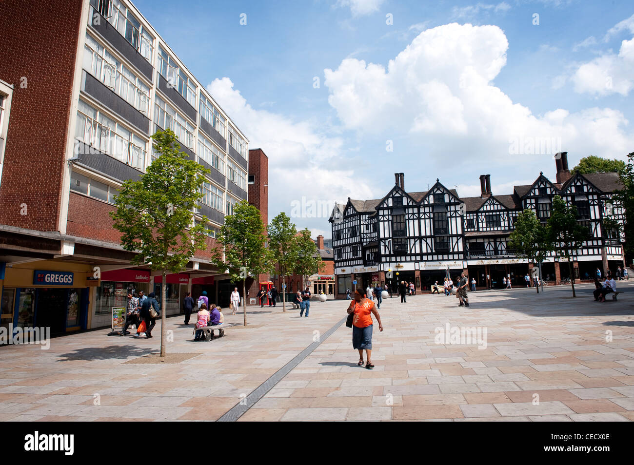 People shopping in Coventry, West Midlands, England. - Stock Image