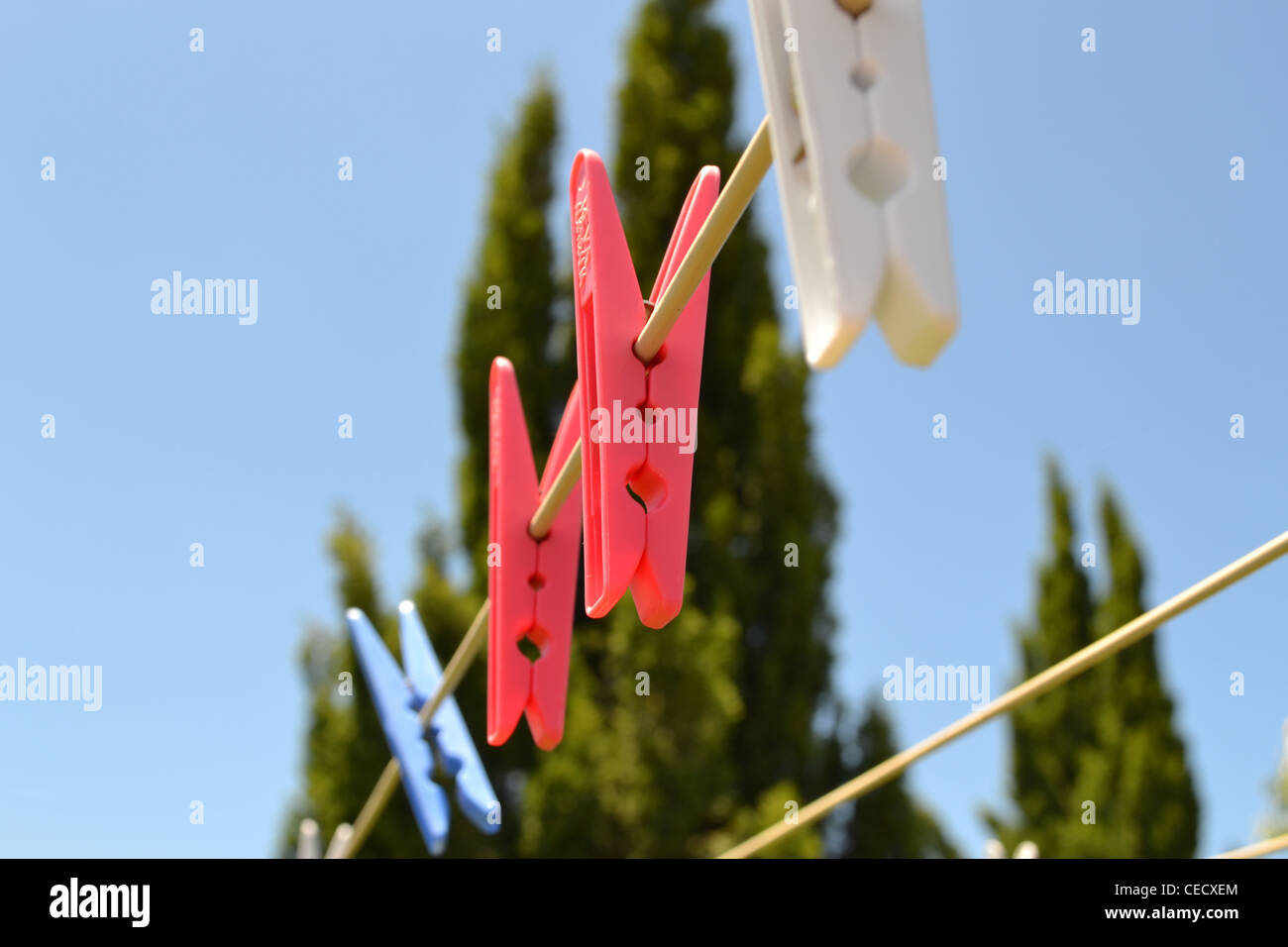 Pegs on a clothesline - Stock Image