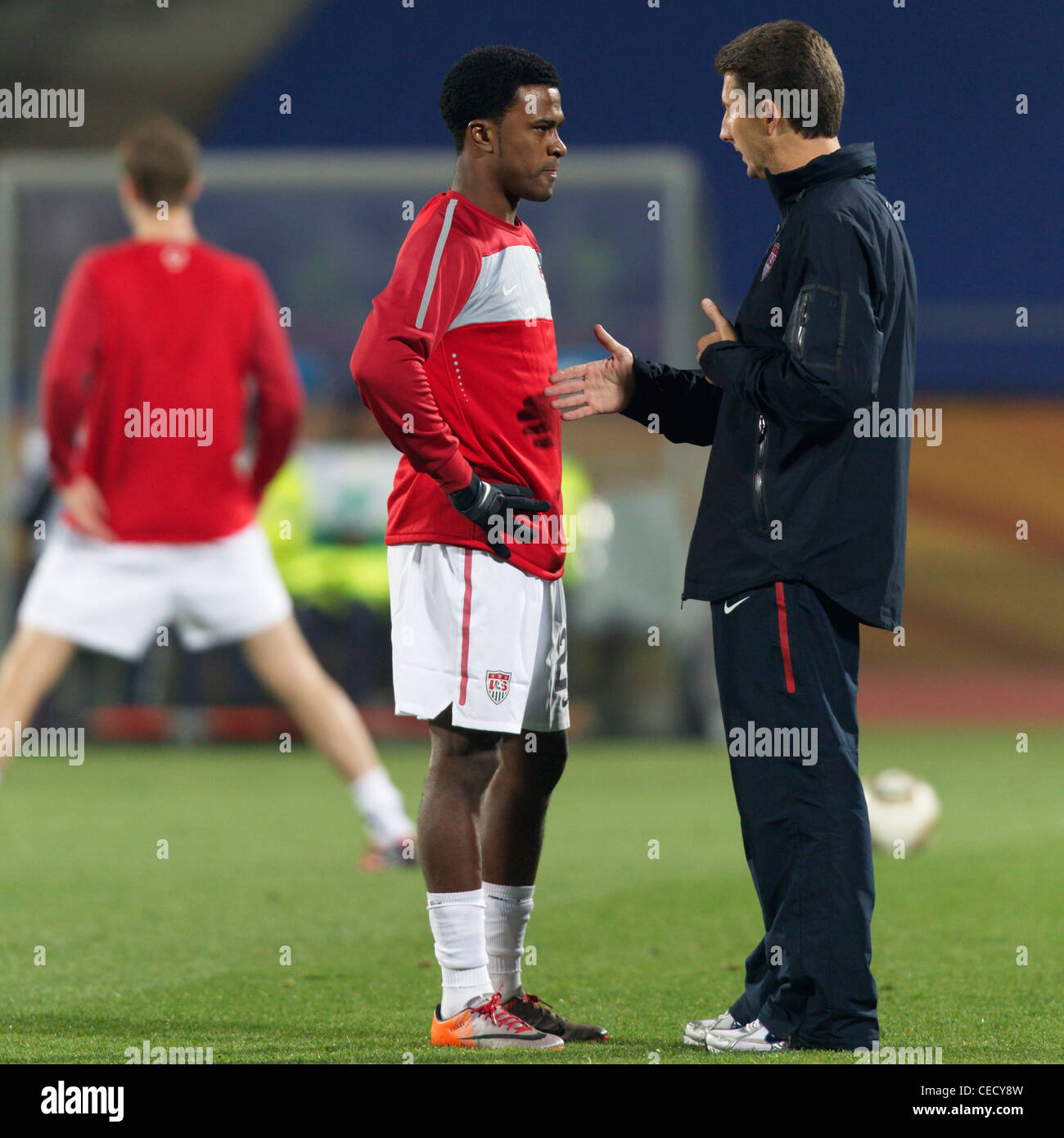 Robbie Findley of the United States (L) receives instruction before a 2010 FIFA World Cup round of 16 match against - Stock Image