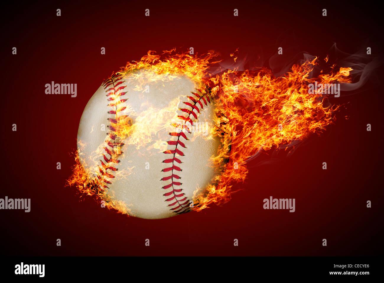 Flying baseball ball on fire - Stock Image