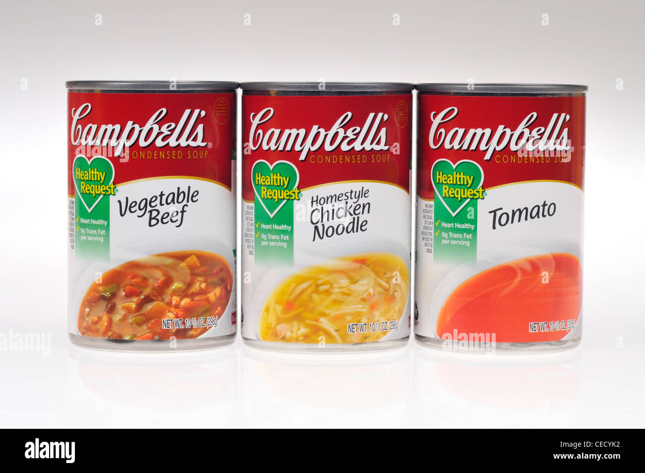 Unopened cans of Campbells healthy request vegetable beef, chicken noodle & tomato soups on white background isolate Stock Photo