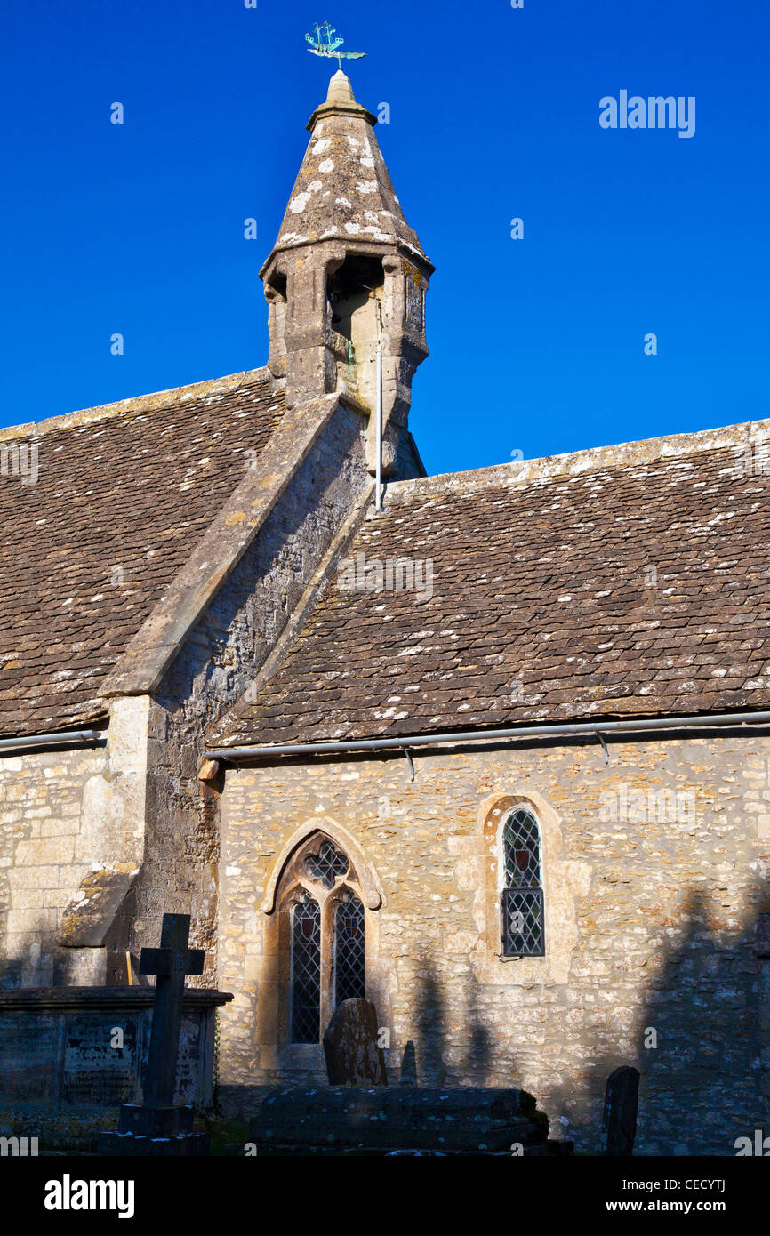 A medieval 13 century bell turret atop an English village church in Biddestone, Wiltshire, England, UK - Stock Image