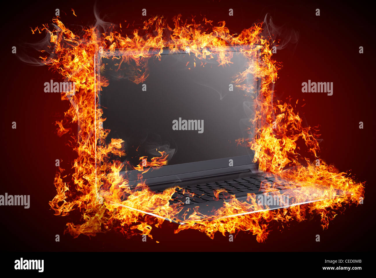 Computer in fire - Stock Image