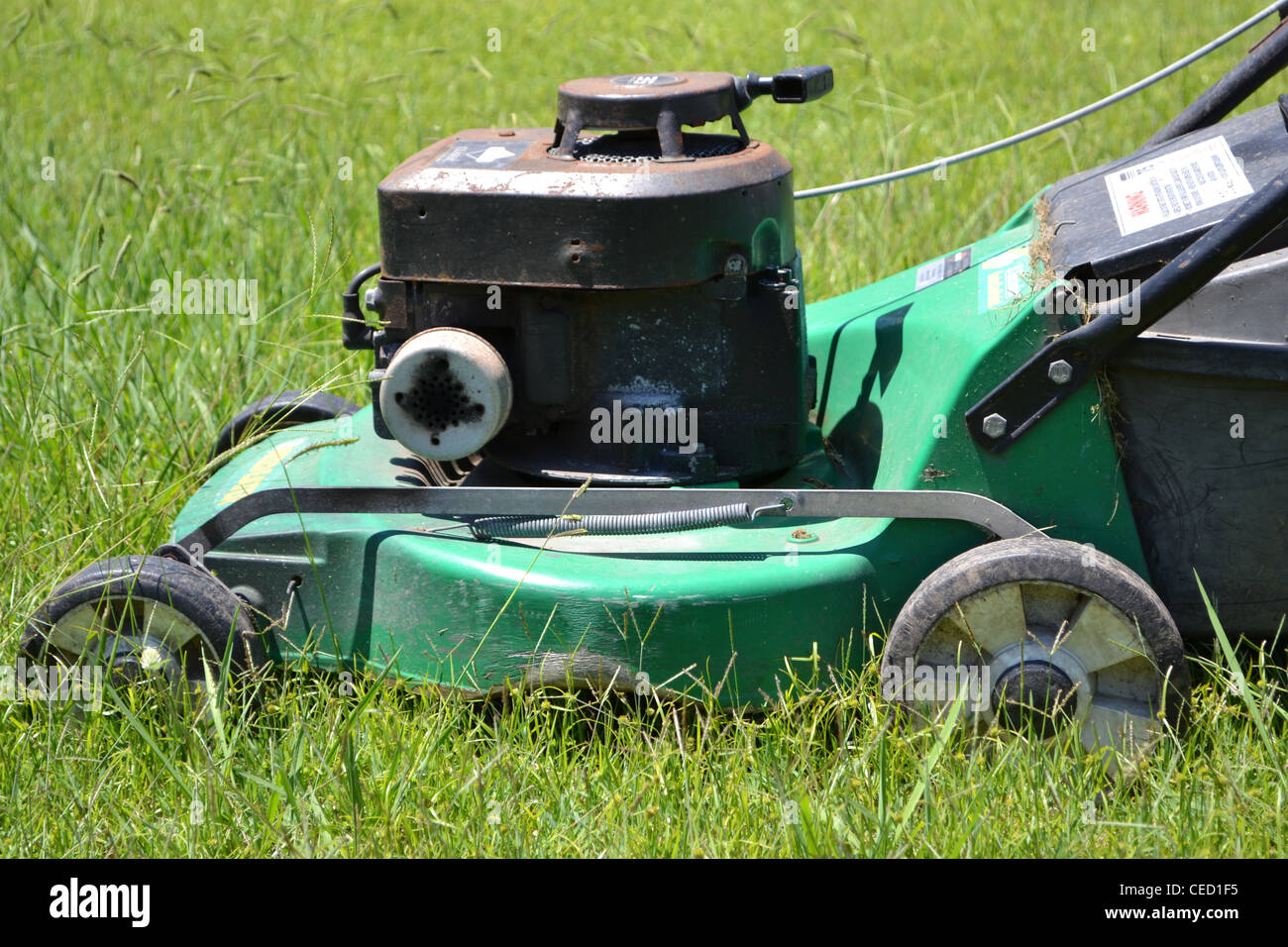 Lawn mower in long grass - Stock Image