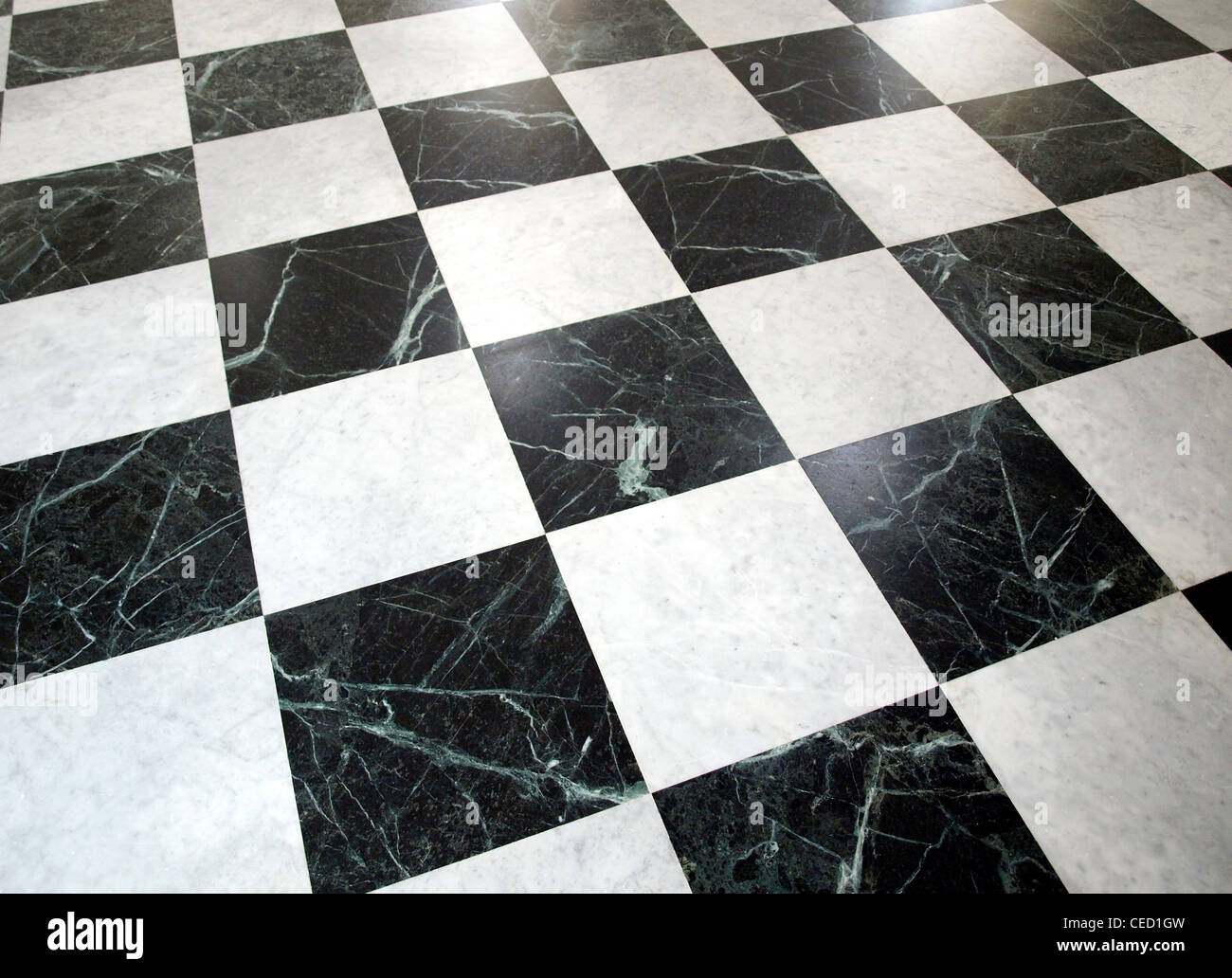 Black and white checked floor useful as a background - Stock Image