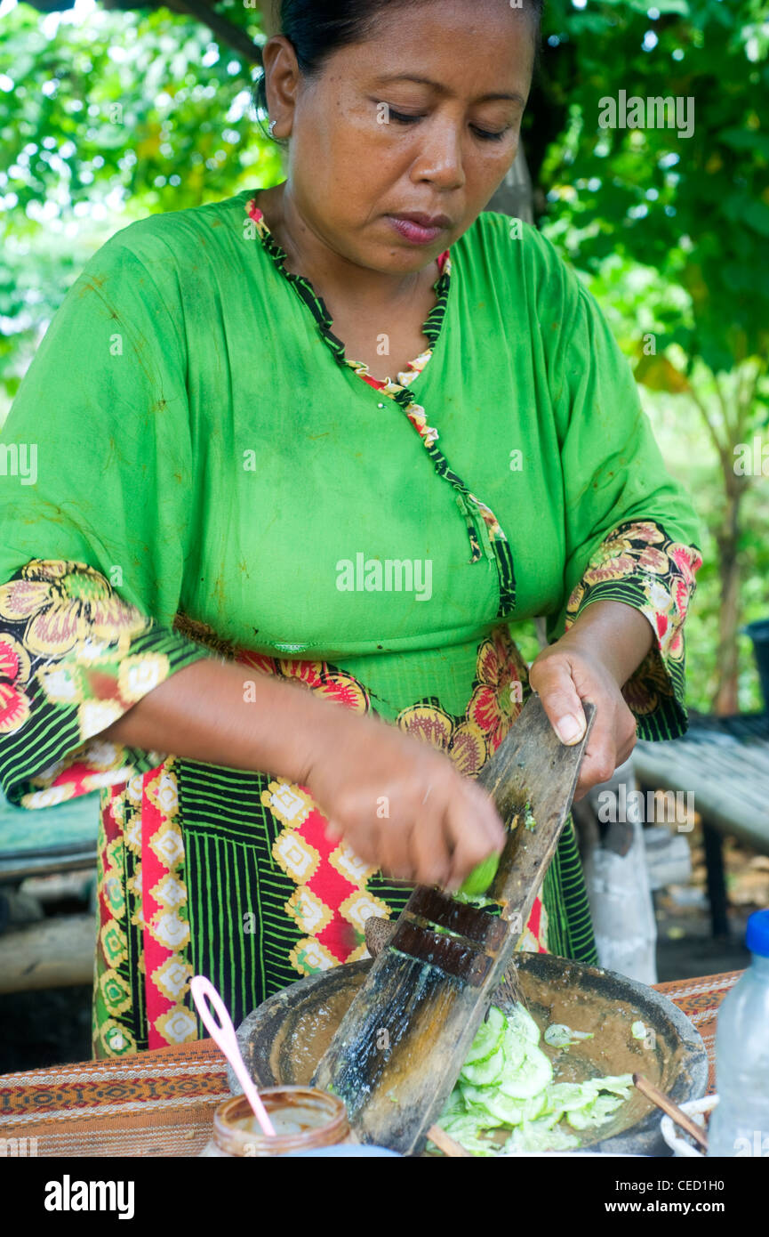 A local woman preparing fast food near the road - Stock Image