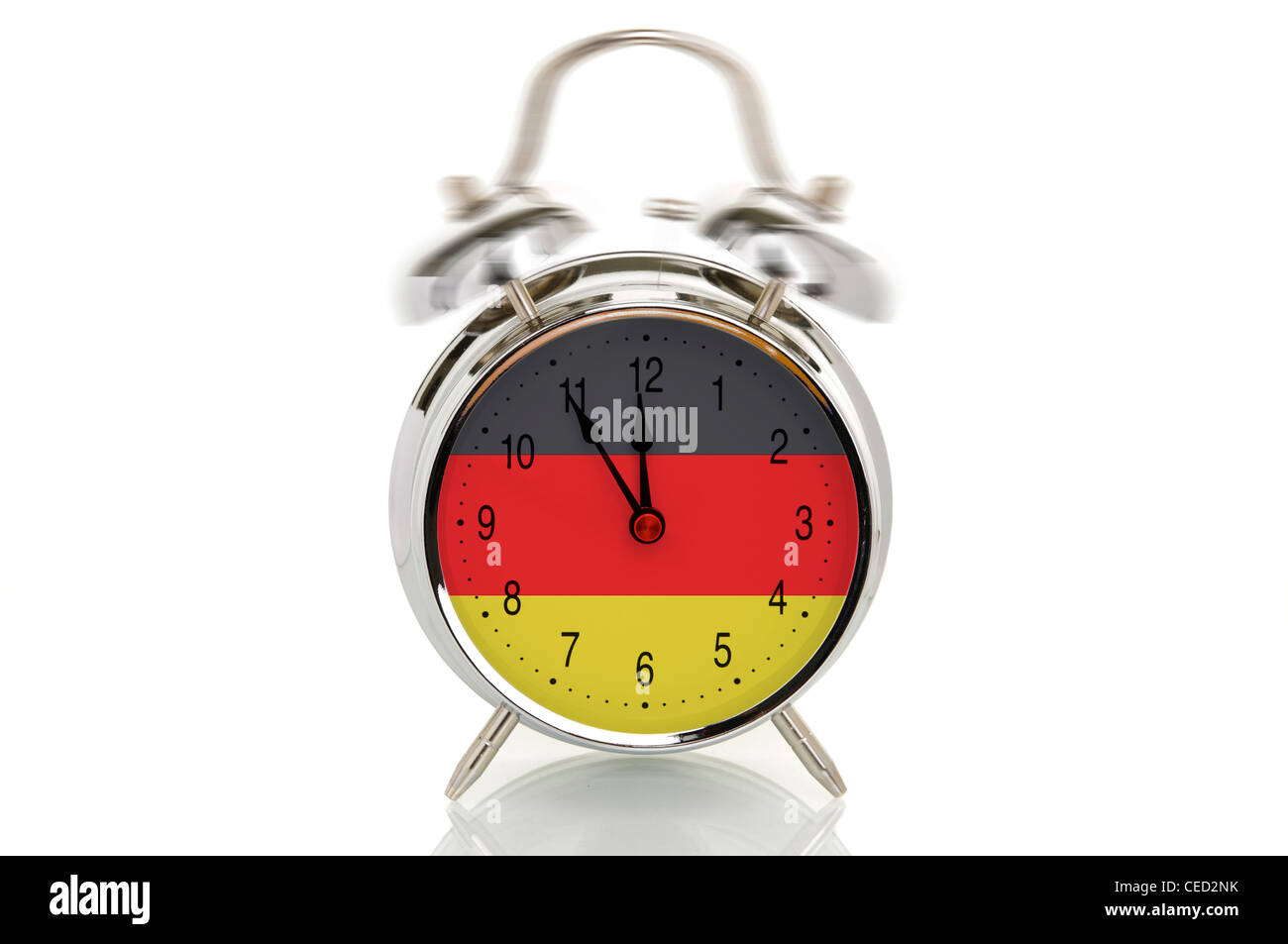 Ringing alarm clock with the German national flag, time set at five minutes to twelve, symbolic image for crisis - Stock Image