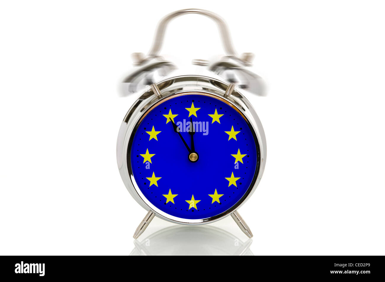 Ringing alarm clock with the European flag, time set to five minutes to twelve, symbolic image for the crisis in - Stock Image