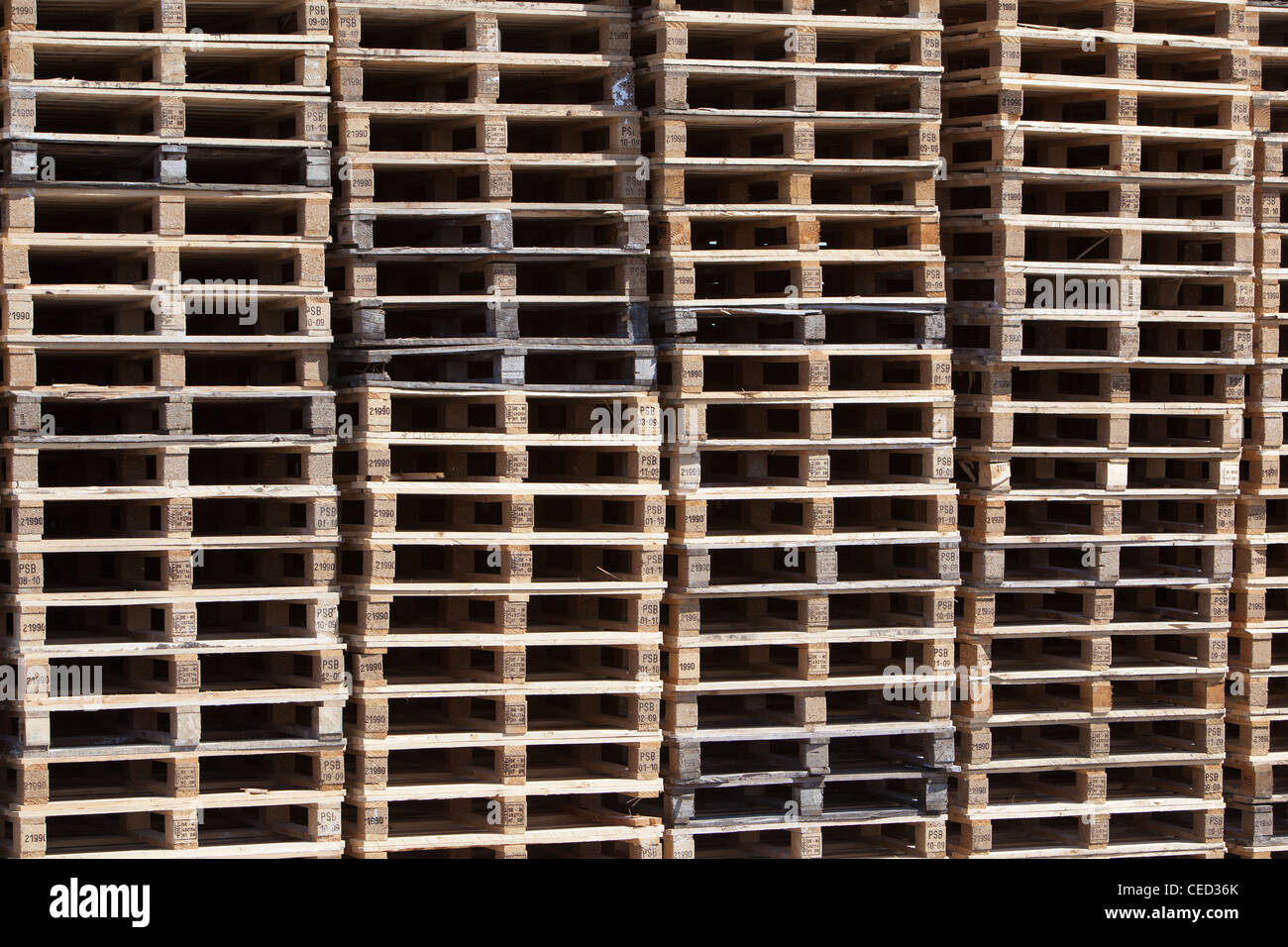 New wooden pallets stacked on harbour quayside Montrose Scotland UK - Stock Image