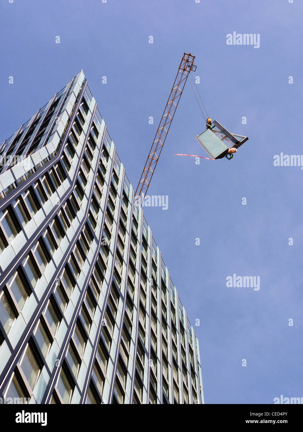 Facade construction work at a high rise building in Hamburg - Stock Image