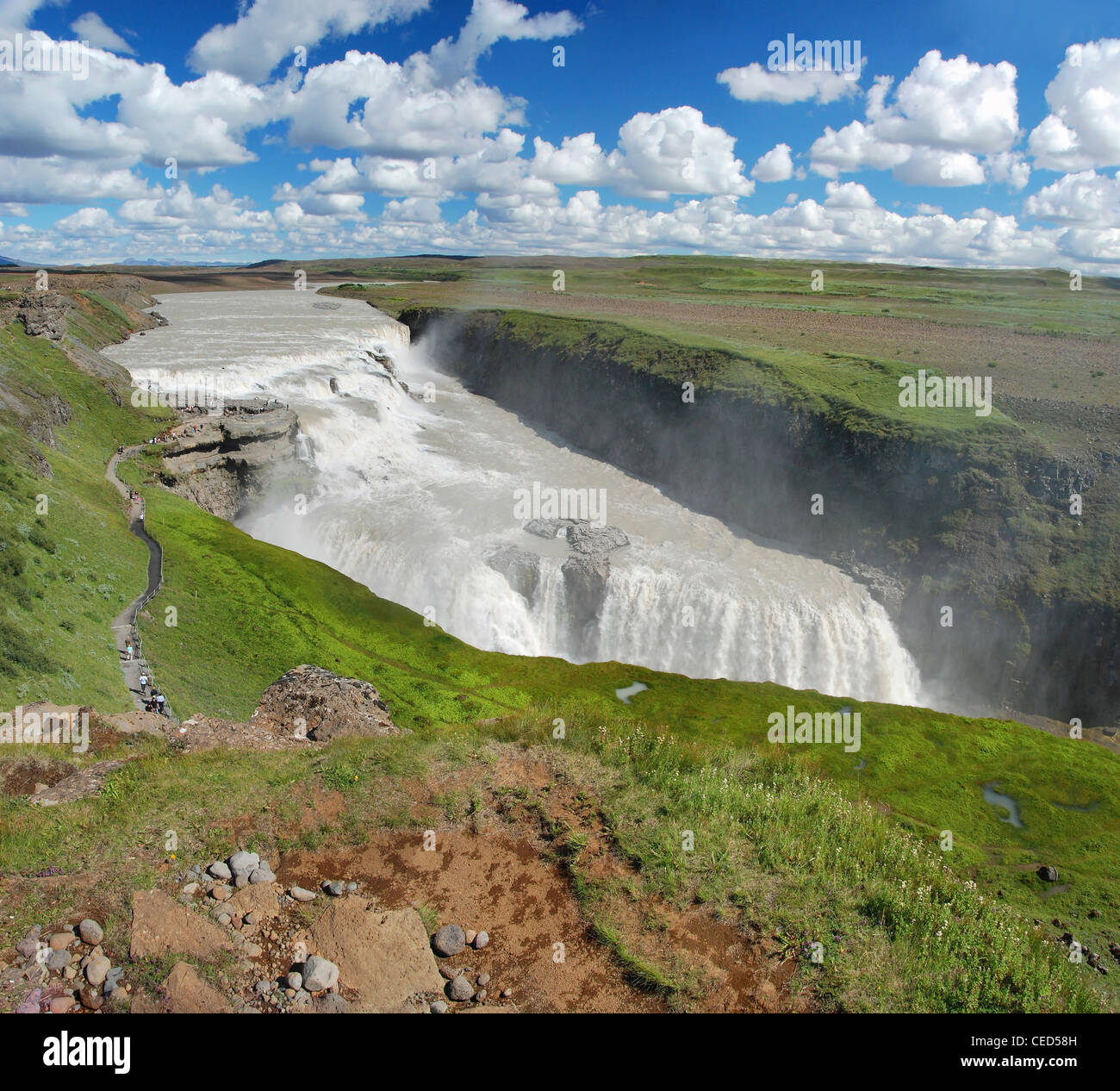 Gullfoss fall on the Iceland with a beautiful blue sky and clouds in background. - Stock Image