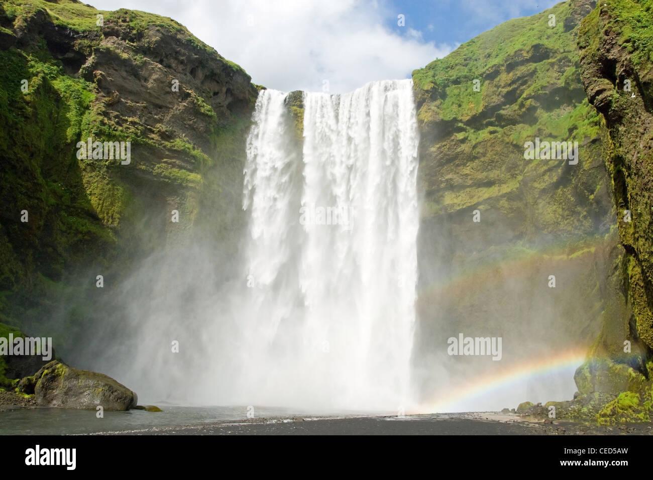 Skogarfoss fall on the Iceland with a rainbow - Stock Image