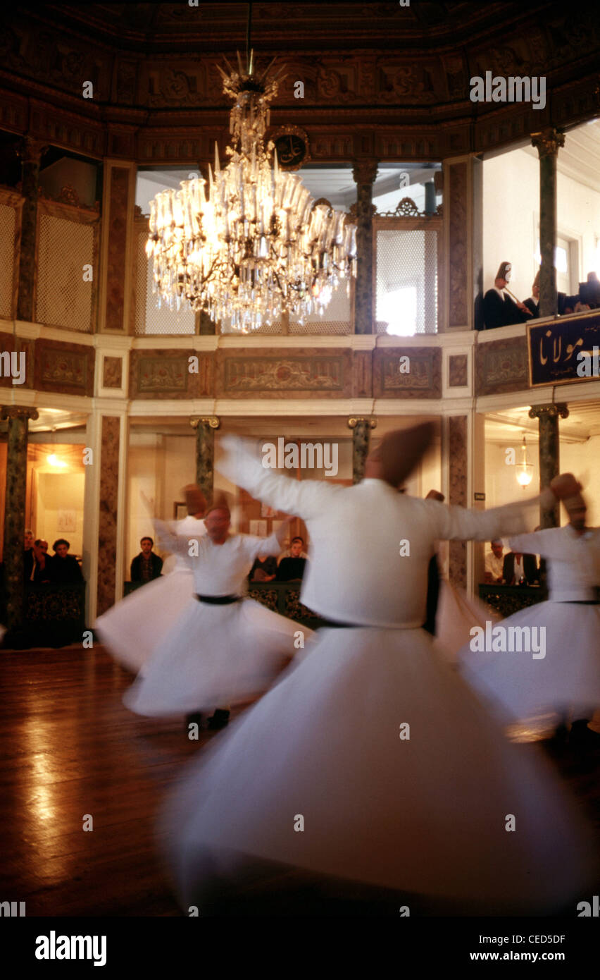 Dervishes perform the Sema ceremony at the Galata Mevlevihanesi, Museum of Court Literature in Beyoglu district Stock Photo