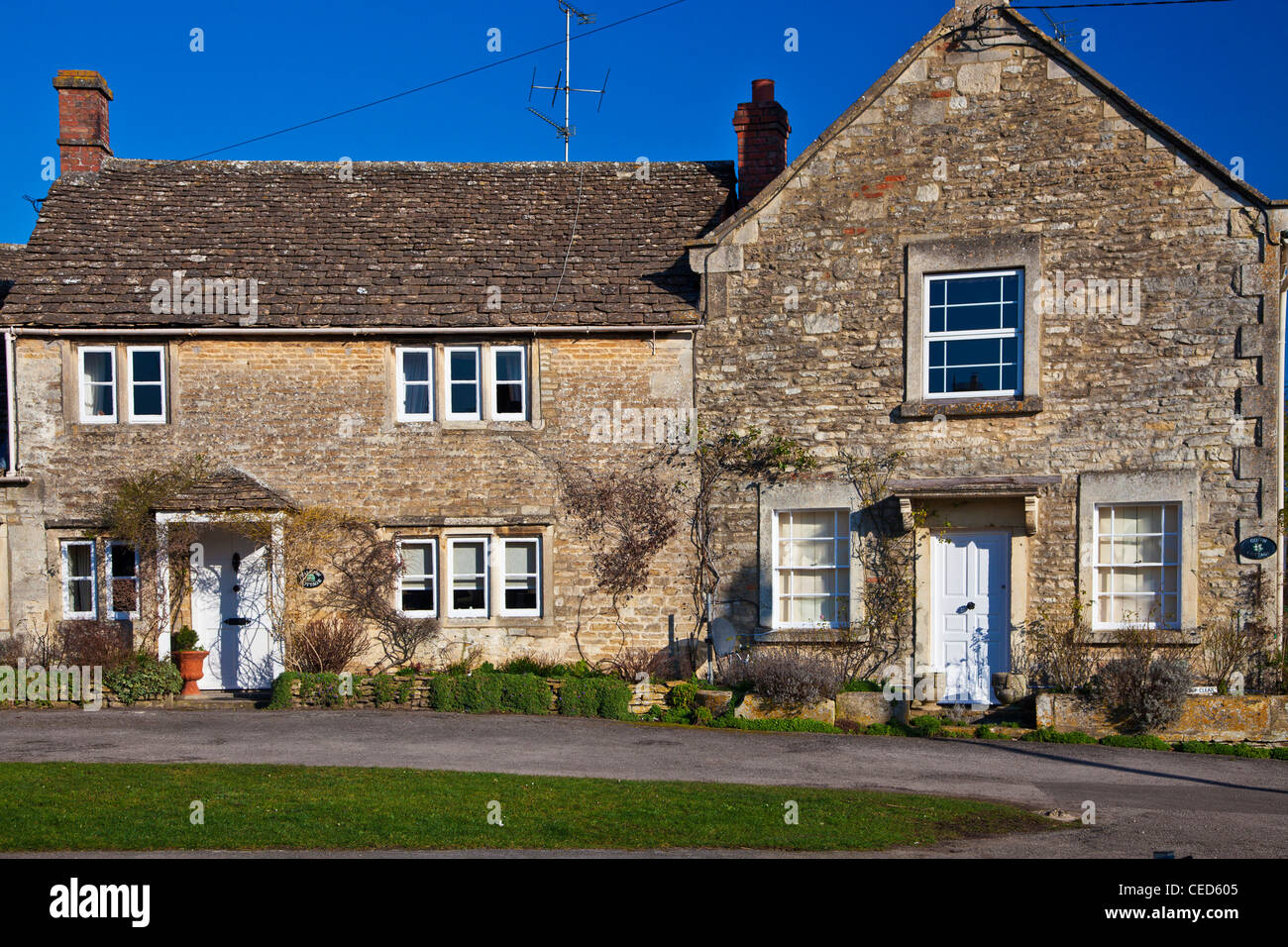 Typical traditional Cotswold stone cottages in the English village of Biddestone, Wiltshire, England, UK - Stock Image