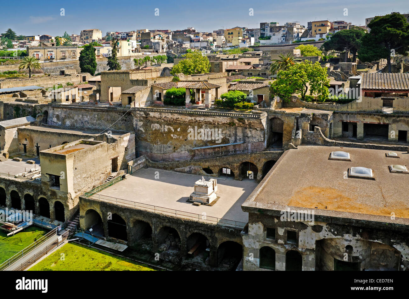 Boat houses along the ancient shoreline with the Sacral Areas above and the Suburban Thermae to the right , Herculaneum - Stock Image