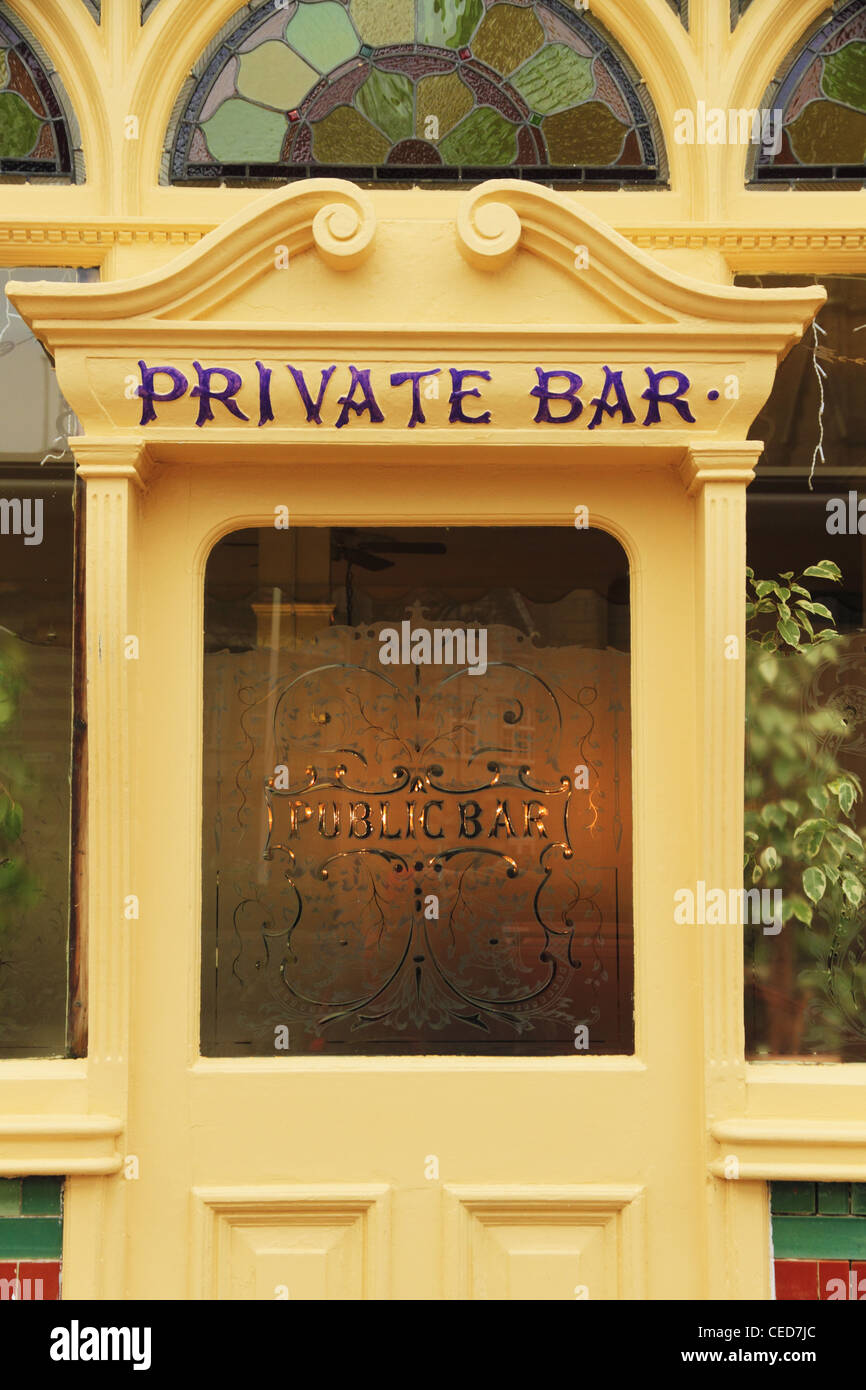 ornate old entrance wooden timber front door to a private public bar ...