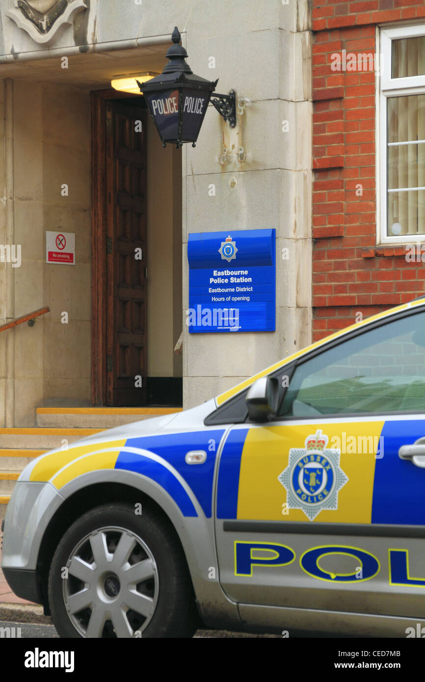A police car parked outside the police station on Grove road, Eastbourne, East Sussex, England. - Stock Image