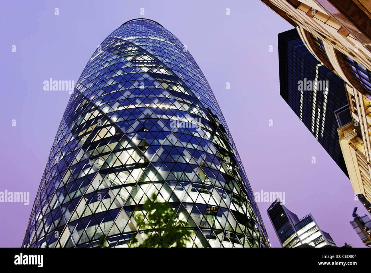 mixed architecture, twilight, modern and classical architecture, Swiss Re Tower, The Gherkin Tower, London, England - Stock Image