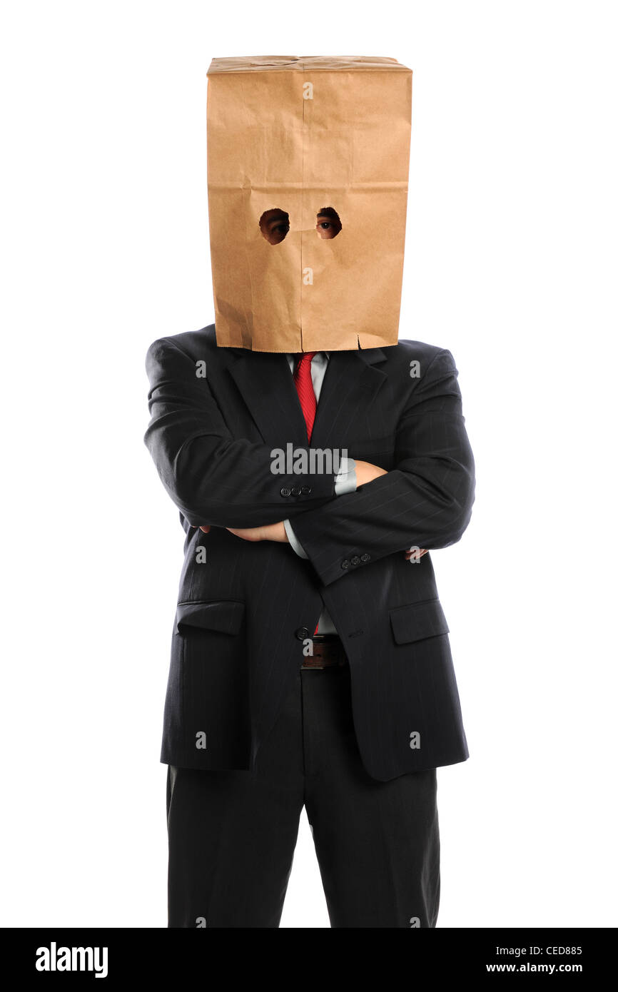 Portrait of businessman with paper bag over head isolated over white background - Stock Image